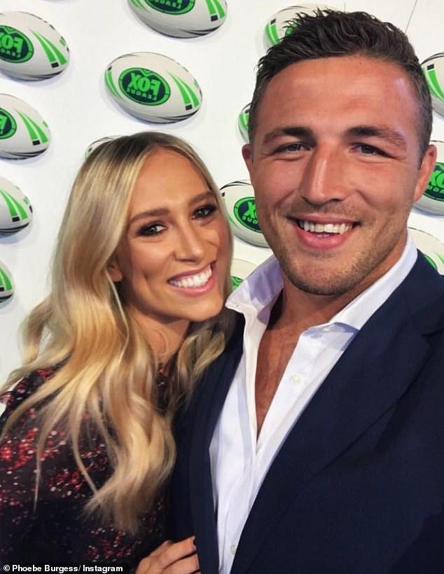 It's over:Phoebe Burgess showed off her ringless wedding finger on Sunday after 'finalising her divorce from former NRL star Sam over Christmas'