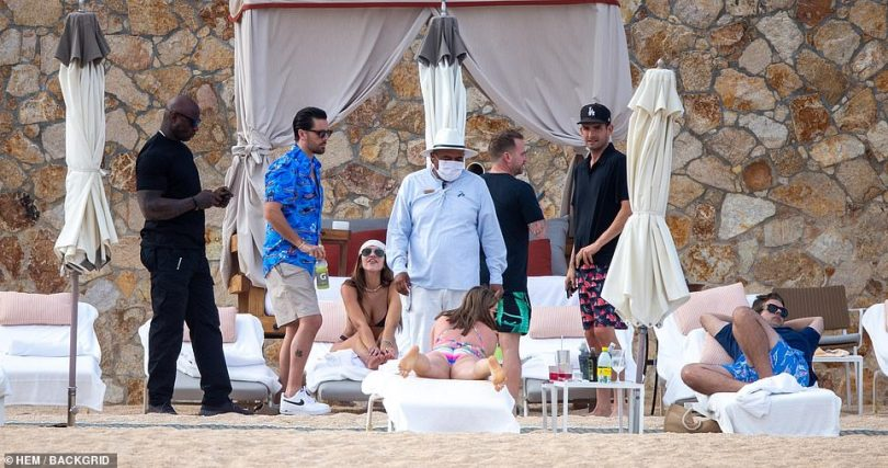 Cabana life: The group was seen without masks as they enjoyed some cabana time