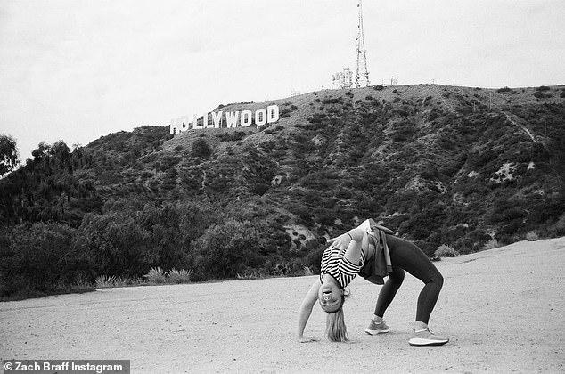 Back stretch: The actress showed her flexibility bending backward in another picture