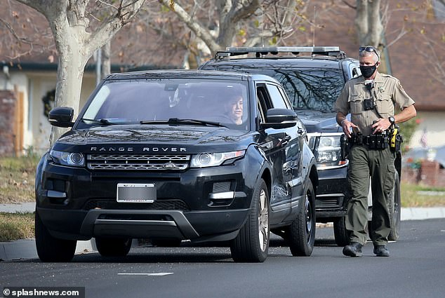 The mother of 'Soho Karen' Miya Ponsetto, Nicole Ponsetto, is spotted talking to cops from her Range Rover a few miles from her home on Sunday