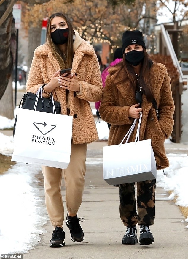 Playing it safe:Kyle Richards appeared to take precautions on Sunday as she indulged in a shopping spree with her eldest daughter Farrah Aldjufrie, 32, in Aspen, Colorado