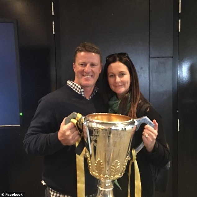 Damien Hardwick (pictured with wife Danielle and the AFL premiership cup) has steered the Tigers to three premierships within four seasons
