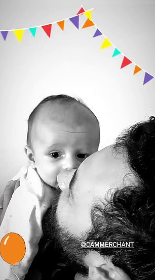 Birthday celebrations: In sweet footage posted on Jules' Instagram story, smitten birthday boy Cameron Merchant (pictured) can be seen playing with his son Ollie and smiling ear-to-ear