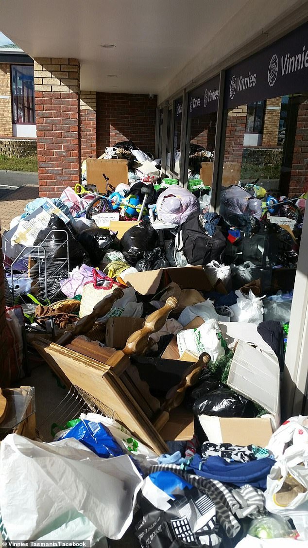 The Vinnies store in Westside Circle, Tasmania shared a horrific photo to Facebook showing just a quarter of the rubbish left outside the shop on December 29 (pictured)