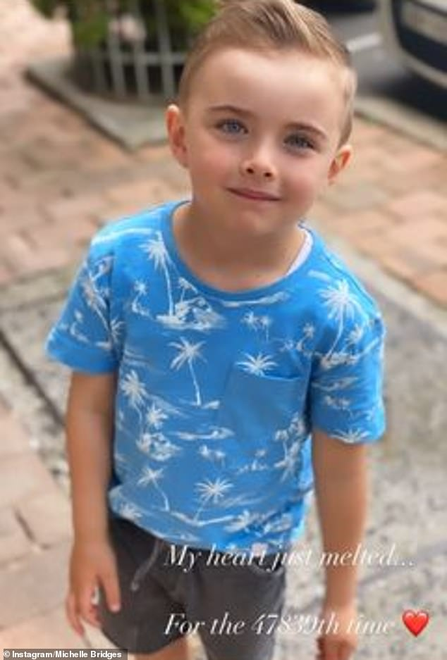 'My heart just melted': Michelle Bridges shared this adorable photo of her five-year-old son Axel after 'his first short haircut' to her Instagram Stories on Monday