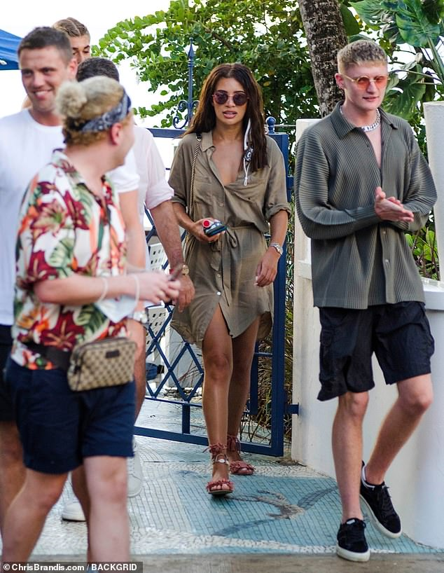 Holiday: Montana Brown flaunted her sun-kissed tan in a khaki shirt dress as she headed out for dinner with pals in Bridgetown, Barbados on Sunday
