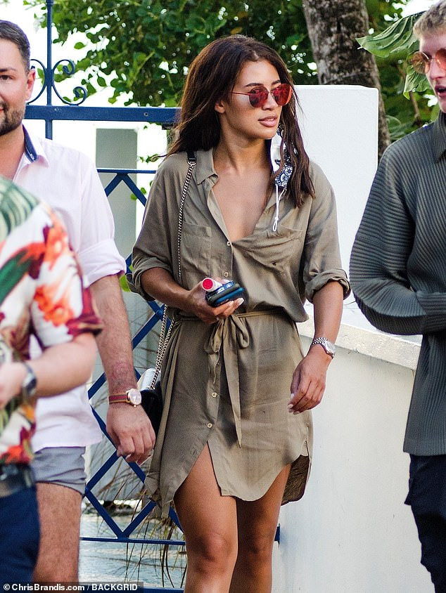Casually-clad: Montana teased a hint of cleavage in the loose-fitting ensemble by wearing the buttons partially undone
