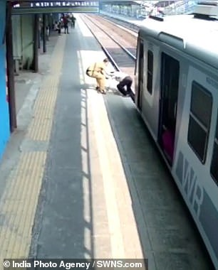 The man narrowly avoids being hit by a train on January 1