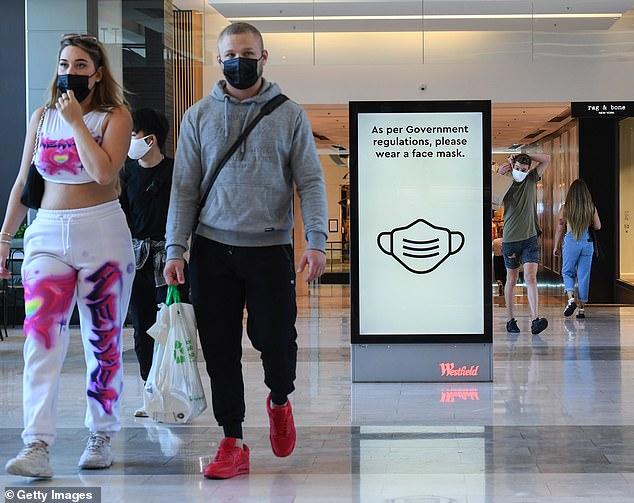 From Monday, Sydneysiders can be fined $200 for refusing to wear protective face masks in public (pictured, shoppers in Westfield Bondi Junction on Sunday)