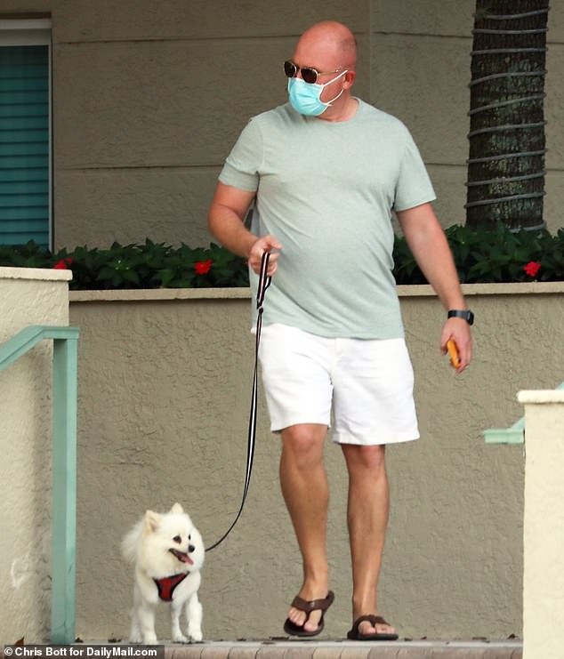 Uchitel's relationship with Batts appeared to move quickly, with the smitten lawyer making it plain he was happy to support her and showering her with gifts, including an iPhone and cordless headphones. Pictured: Batts walking Uchitel's small dog in Palm Beach, Florida