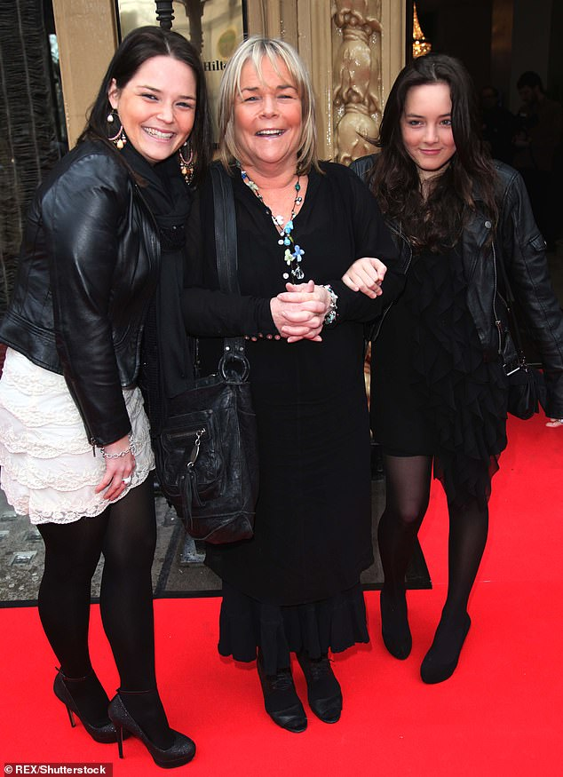 We are a family: The star is pictured in 2011 with her daughters Lauren and Roberta.  She is also the mother of son Louis