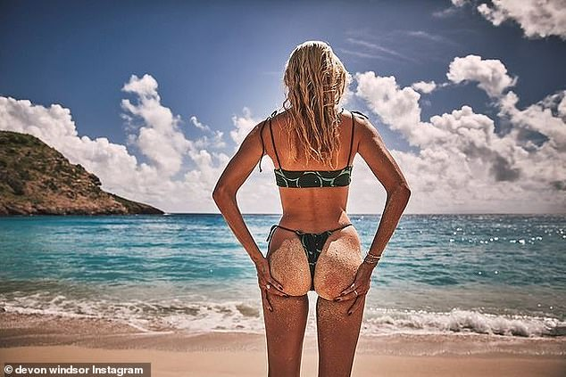 The backside: And her bottom was sandy as she looked out at the horizon