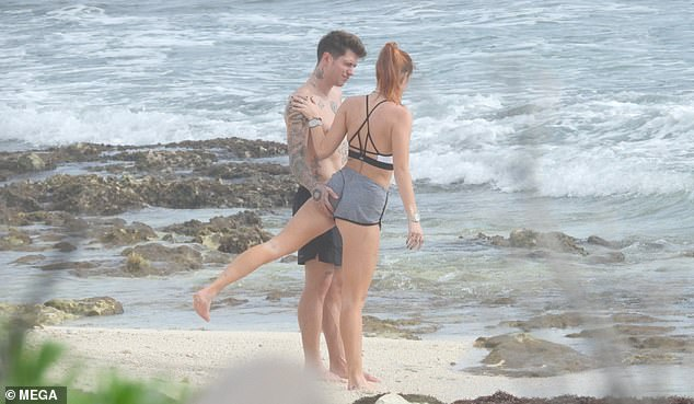 Handsy: Her Italian-born boyfriend could not help but cop a feel of her backside as she did some leg lifts