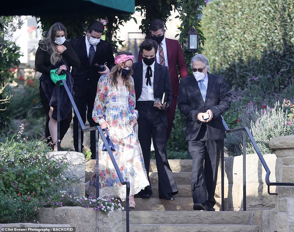 Bond:The Adore You hitmaker stayed close by his new love's side as they chatted with the rest of the wedding party during the special day