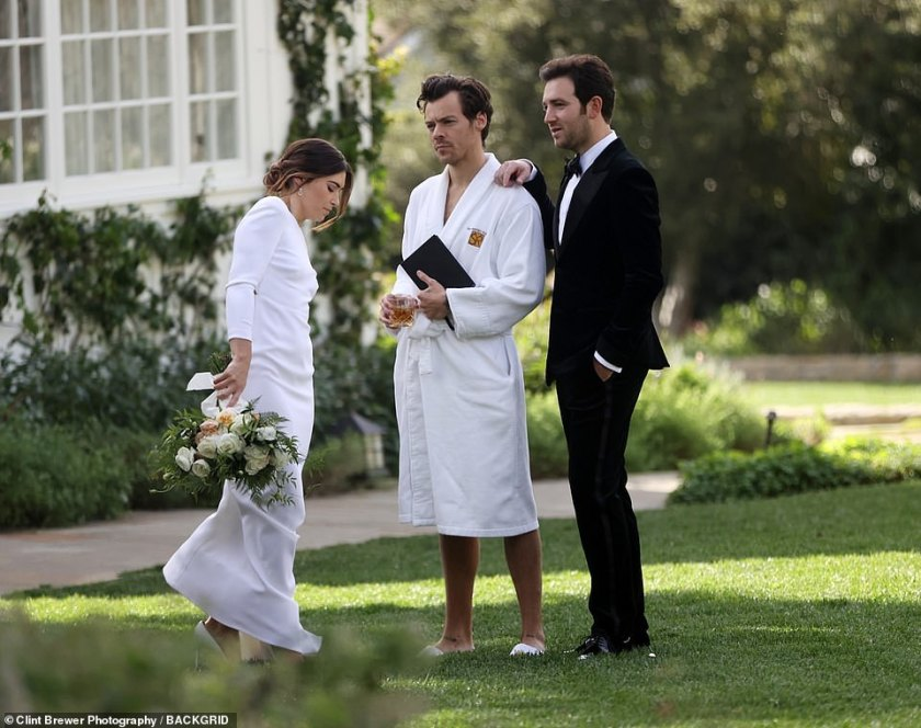 Lol: The singer later donned a white towelling robe and sliders as he crashed the wedding shoot between Jeffrey Azoff and Glenne Christiaansen