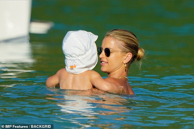 Uh oh!Vogue - who lives in Battersea, London , with husband Spencer Matthews and their two children - looked happy as she enjoyed a day on the beach in the French Caribbean, despite rules advising against all but essential travel from the UK