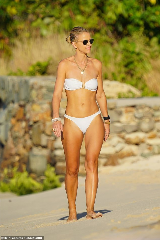 Living it up:Vogue Williams appeared to be making the most of her family getaway to St. Barts on Tuesday after flouting Tier 4 rules in London in order to make the trip