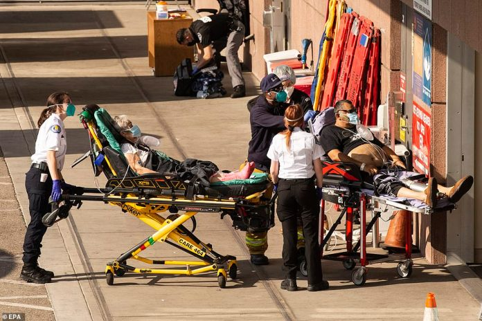 CALIFORNIA: The health crisis continues to be especially dire in California, which reported 31,440 cases, 368 deaths and 22,485 hospitalizations on Monday. Pictured: Patients are wheeled into the ER at LAC USC Hospital in Los Angeles