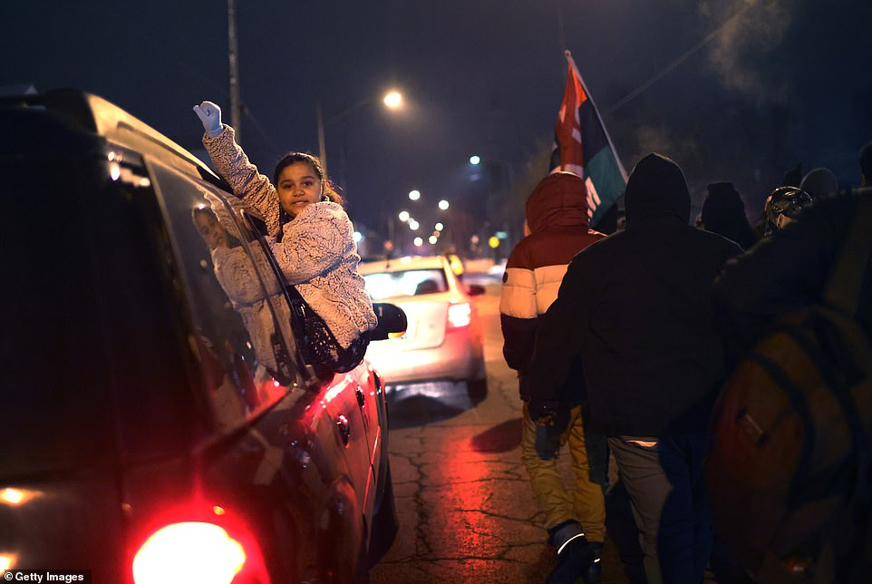 Demonstrators travel in a caravan through town to protest Kenosha County District Attorney Michael Graveley's announcement