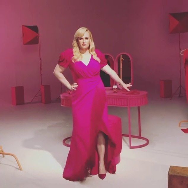 Pretty in pink! Rebel Wilson proudly showed off her slimmed-down figure during a photo shoot on Tuesday