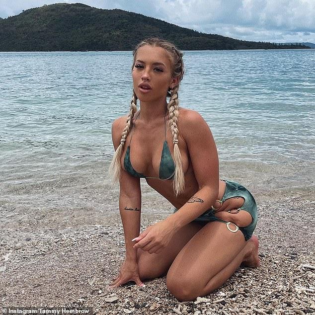 Tammy Hembrow embraces her wild side as she poses on the beach in arisqué tie-dye bikini