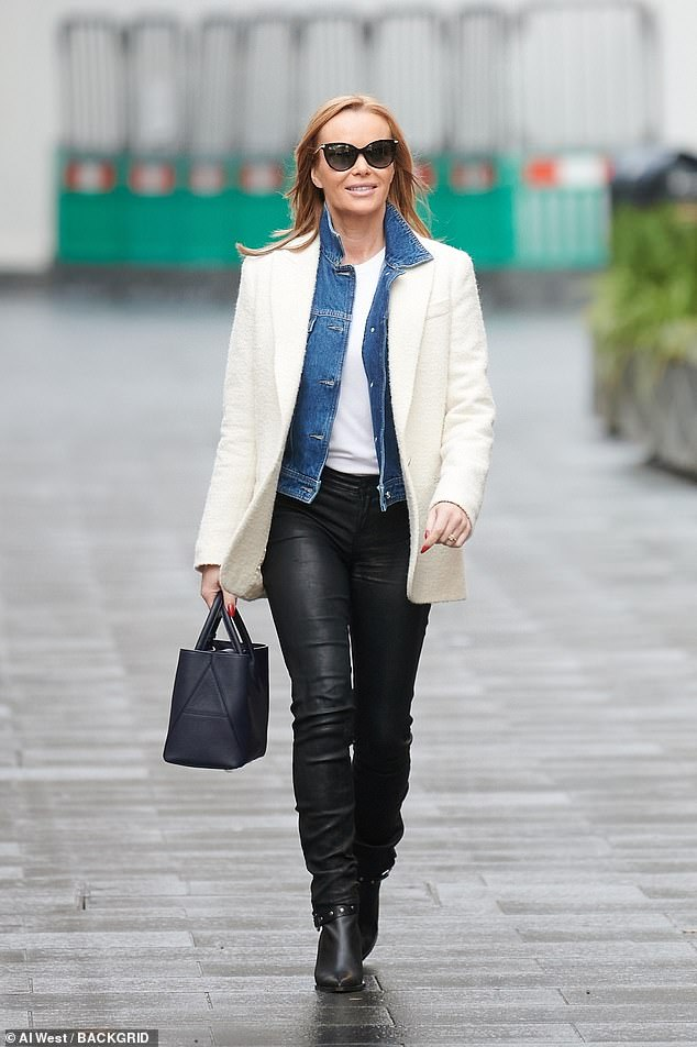 Outfit:The Britain's Got Talent judge, 49, displayed her sense of style as she donned a cream coat which she paired with skintight black leather trousers