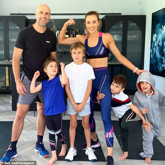 Family: Rebecca shares son Oscar, nine, daughter Billie, six, and twins Tom and Darcy, four, with her husband of 10 years, former Australian rules footballer Chris Judd (all pictured)