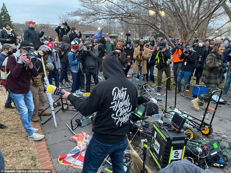 Journalists and TV crews were forced to abandon the area and flee as the violent thugs wielding sticks pushed over a barricade and entered the area where they had set up