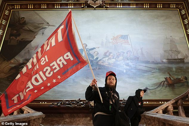 Painting behind Trump supporter who stormed Capitol shows the last time the Capitol was stormed