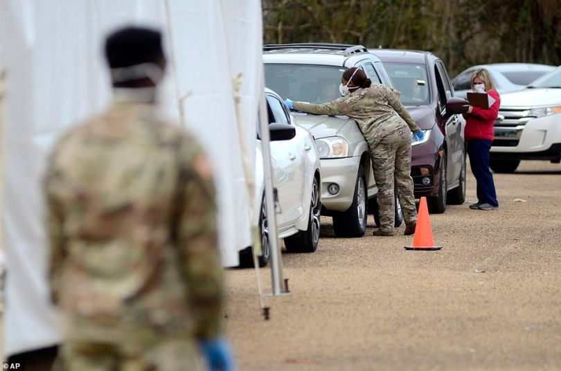 MISSISSIPPI: Mississippi National Guard and state department of health officials assist people waiting in line to receive COVID-19 vaccinations at a drive-thru vaccination set up at the Pike County Health Department in McComb