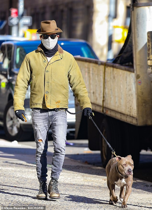 Justin's best friend:Justin Theroux was seen out yet again walking his beloved pooch Kuma on Thursday, maintaining his unique and unmistakable style