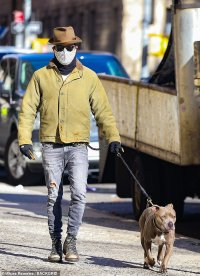 Justin Theroux rocks a chic fedora hat while taking a sunny stroll with his adored pooch Kuma in NYC