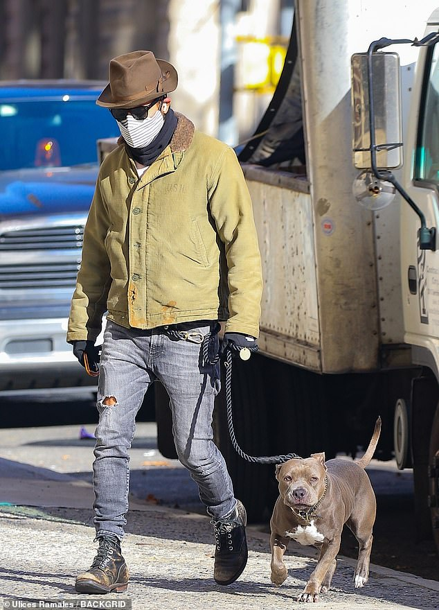 Snazzy:The Leftovers star, 49, was in a fashionable yet somewhat drab olive green jacket, anda chic light brown fedora hat
