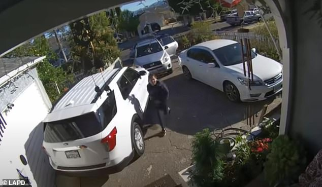 Ruiz is seen above as she sprints toward the door in terror after a man in a sedan pulled up into the driveway of a home on the9000 block of Bartee Avenue in Pacoima on Wednesday morning