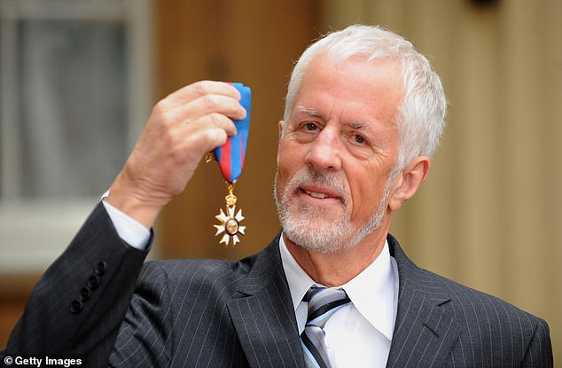 Apted poses for photographs after receiving the Order of Saint Michael and Saint George from Queen Elizabeth II at Buckingham Palace in 2009