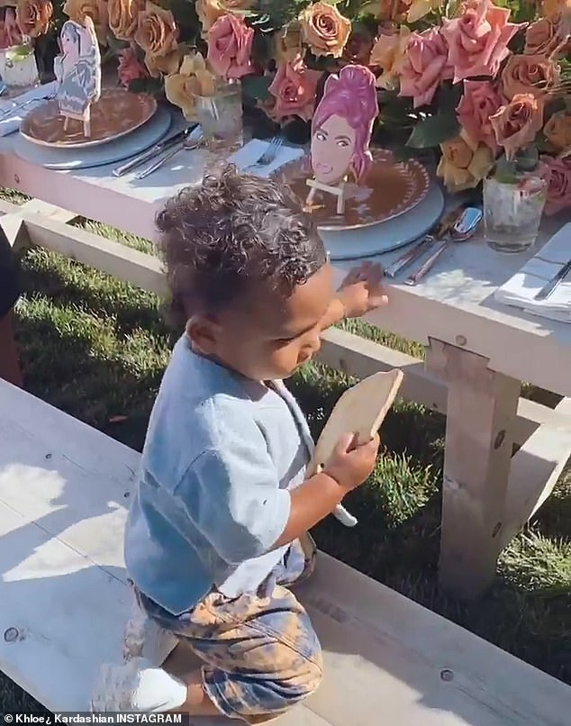 Chowing down: Khloe also filmed her nephew Psalm Kardashian West as he played on the bench and munched on the cookies