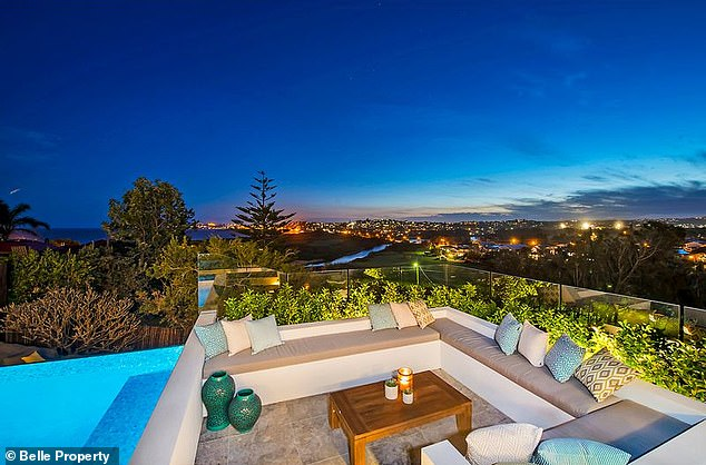 Stunning view: The resort style home features five spacious bedrooms, an expansive walk-in wardrobe, and an infinity pool that looks out to the beach
