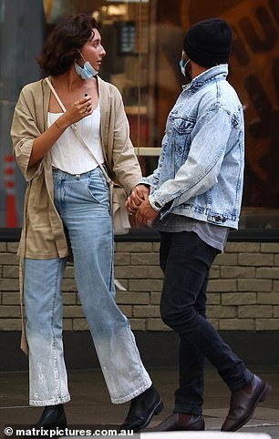 Casual: High School Musical star Zac cut a casual figure in black skinny jeans, which he teamed with a grey shirt and a light blue denim jacket