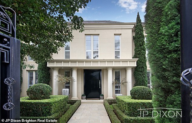 Grand entrance: The 51-year-old offloaded the property after it was passed in at a private auction at $5.65million last month, realestate.com.au reported