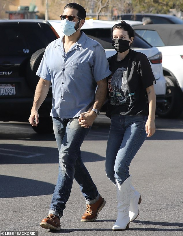 Sweet: Jesse Metcalfe kept a low profile in a shirt and denim jeans on Friday as he held hands with Corin Jamie-Lee Clark and they visited the shops in Los Angeles for gardening supplies