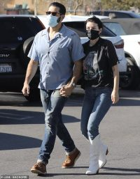 Jesse Metcalfe cuts a casual figure in a shirt and jeans and holds hands with Corin Jamie-Lee Clark