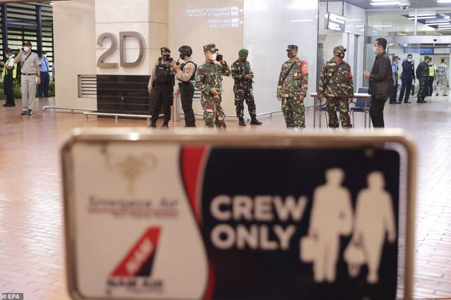 Indonesian military is seen at Soekarno-Hatta International Airport today. The budget airline - which has about 19 Boeing jets that fly to destinations in Indonesia and Southeast Asia - said only it was investigating the incident