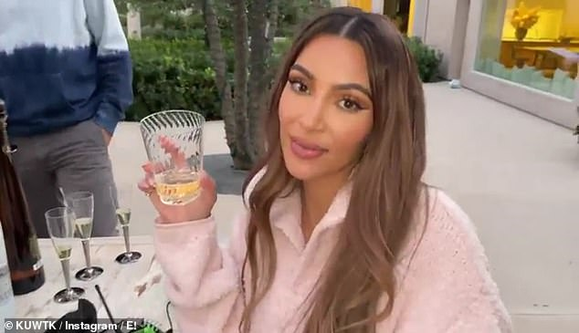 Done forever: Kim led a champagne toast with the crew as she told her fans 'cheers to 20 seasons of craziness and lots of love'