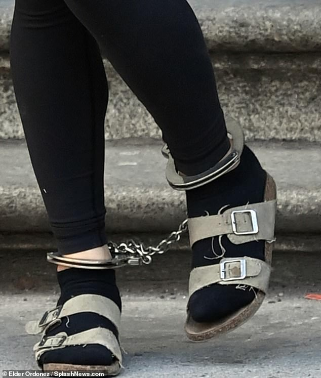 She was seen wearing frayed sandals with socksPonsetto was led out shackled by her wrists and handcuffs.