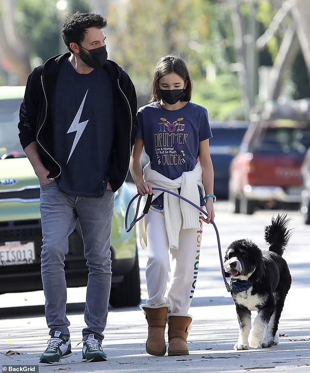 Catching up: Ben Affleck, 48, went out for a morning stroll with his middle child Seraphina, 12, on Saturday