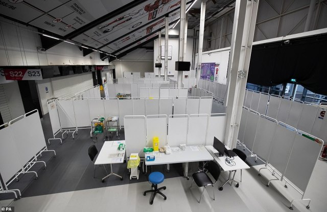 Vaccination booths are pictured inside Ashton Gate Stadium in Bristol, which is one of seven mass vaccination centres which will open on Monday