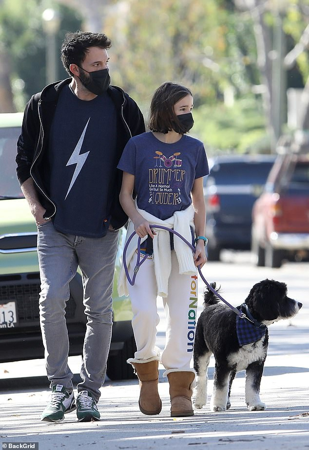 Comfy: Seraphina wore a blue graphic T-shirt reading, 'Drummer girl: Like a normal girl but so much louder,' plus $138 Aviator Nation sweatpants and brown Ugg boots