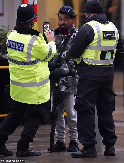 Police officer took a picture of one man