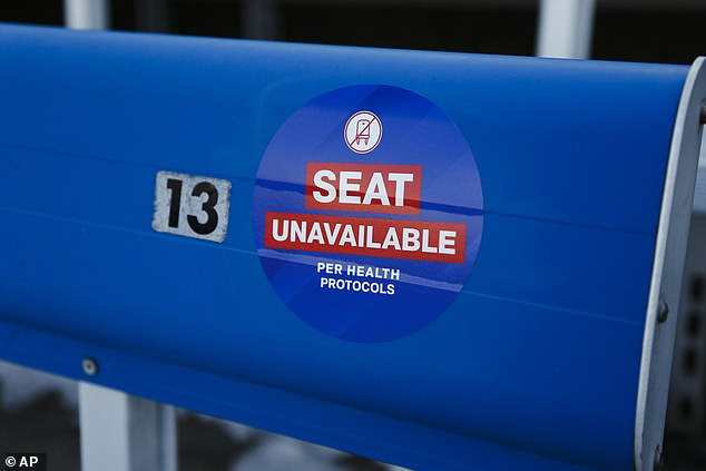 Health protocols are in place for fans as they arrive at Bills Stadium before Saturday's game