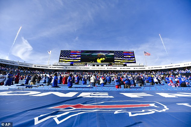 Buffalo Bills fans stand during the national anthem ahead of Saturday's playoff gmae
